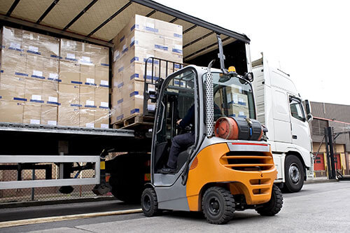 ASAP Transport Solutions. Boxes being unloaded from a truck on an LTL delivery.